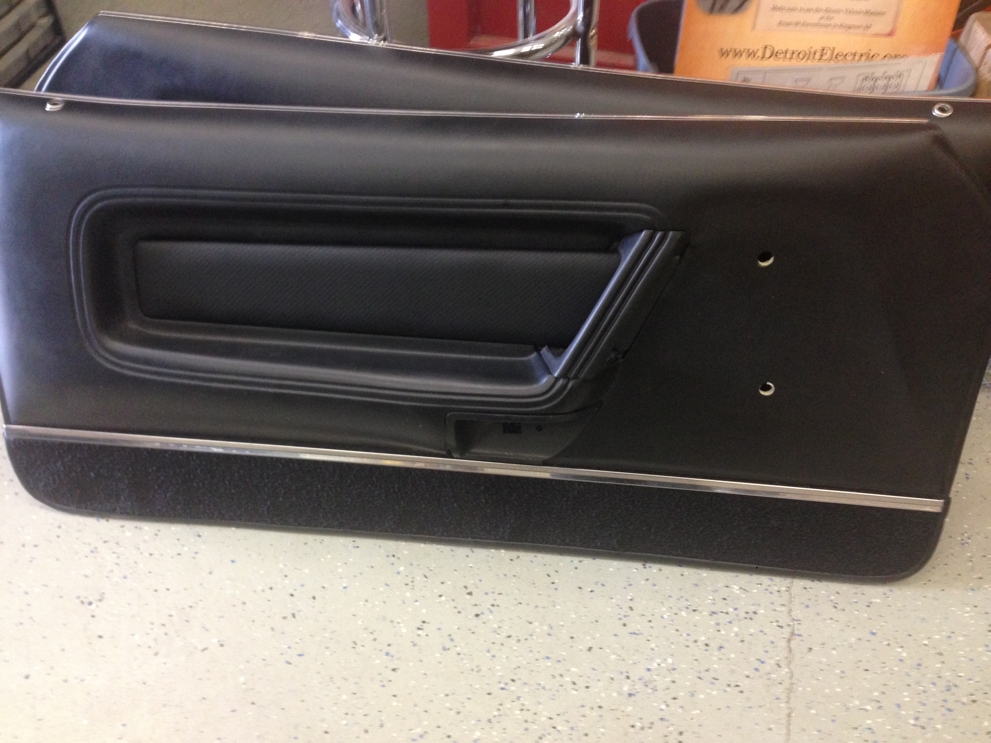 Door panel with carbon fiber panel installed